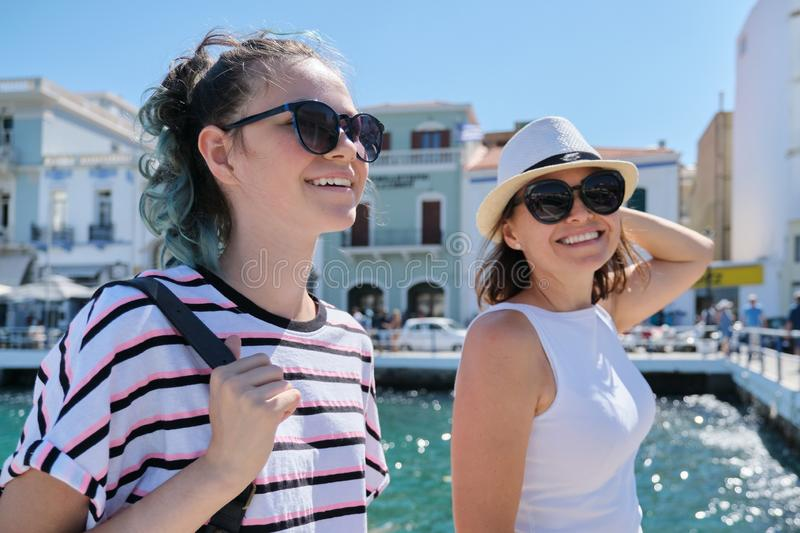 Walking happy mother parent and teenage daughter summer holidays together stock images