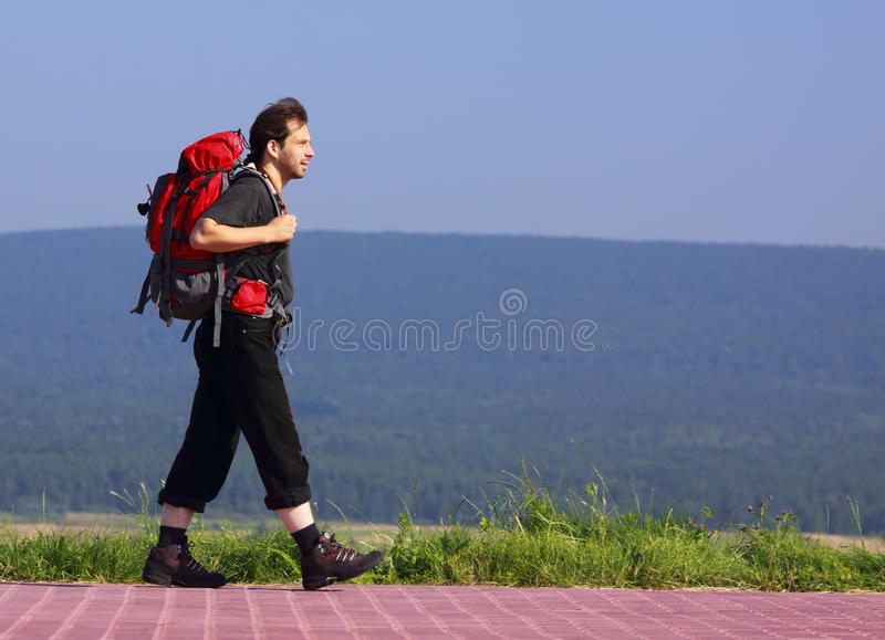Walking hiker royalty free stock photo