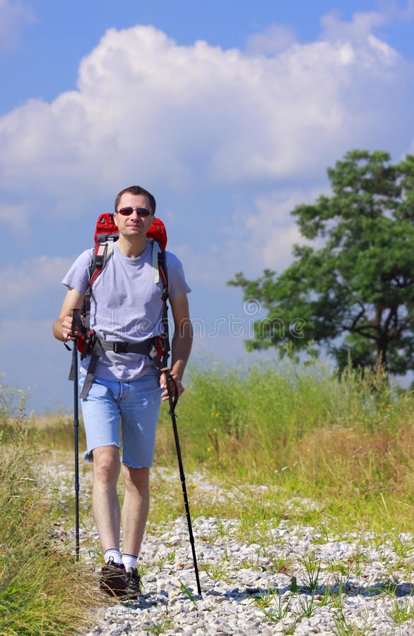 Walking hiker on stony path royalty free stock photos
