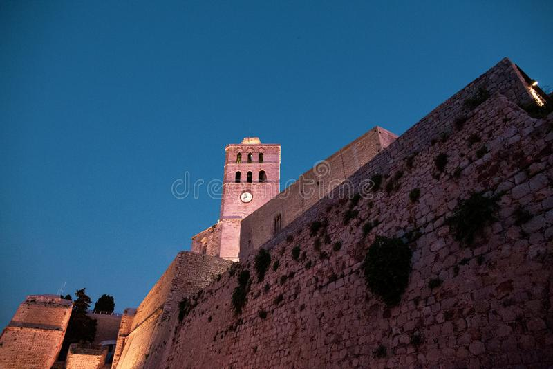 Walking in Ibiza`s medieval age old town and fortress Dalt Vila, in Ibiza Town: the cathedral. L royalty free stock photo