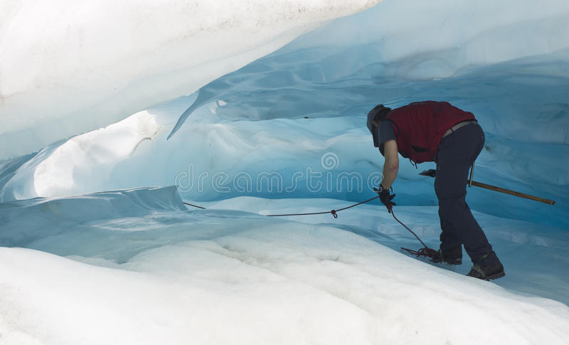 Walking in ice cave stock image
