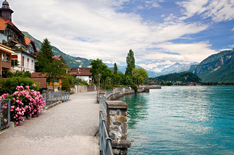 Walking by the Lake in Brienz, Berne, Switzerland. This is a view of the lake and Municipality of Brienz in the district of Interlaken in the canton of Berne in royalty free stock images