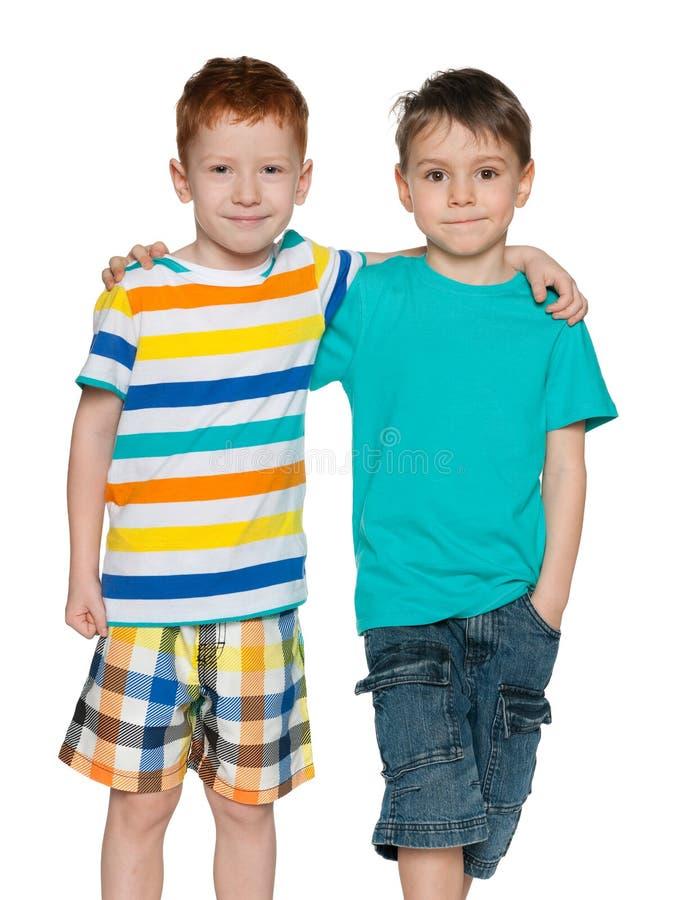 Walking little boys stock photo