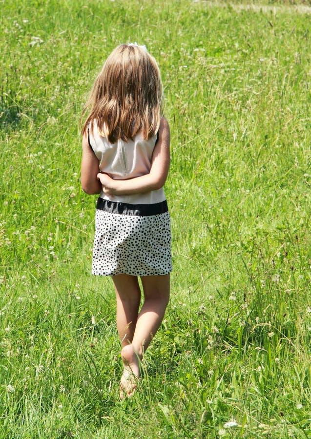 Walking little girl stock images