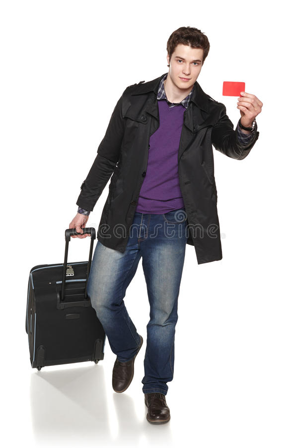 Walking male tourist wearing autumn jacket showing empty credit card stock photography