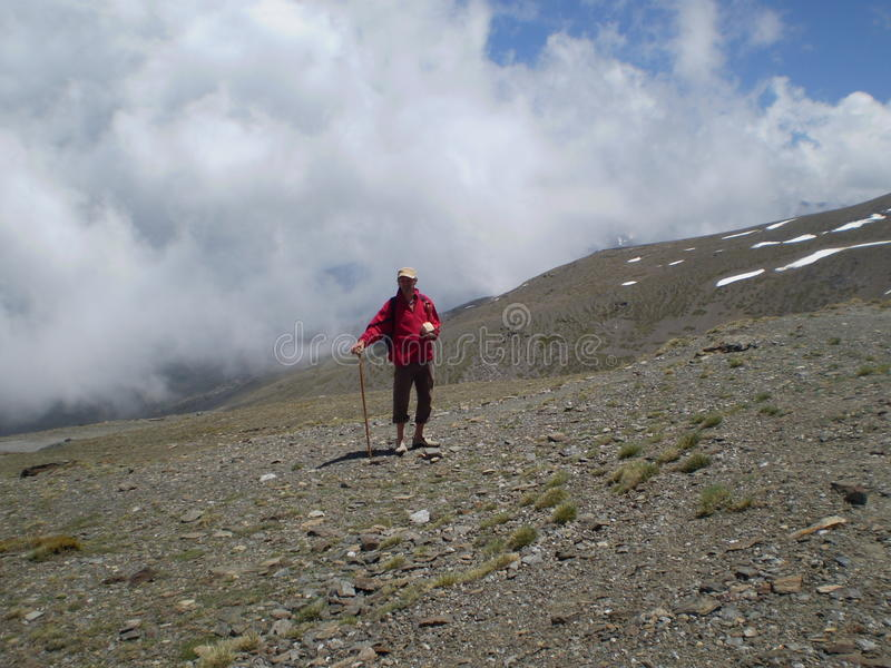 Walking man. Man walking through the mountains in the sierra nevada in Spain royalty free stock photography