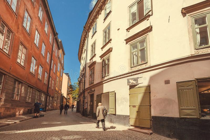 Walking man in shadow of Gamla Stan, Old Town historical area stock photography