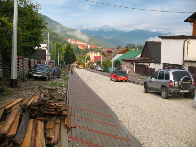 Sochi, Russia - September, 2013: Road repair on main street of olympic village in Krasnaya Polyana royalty free stock photography