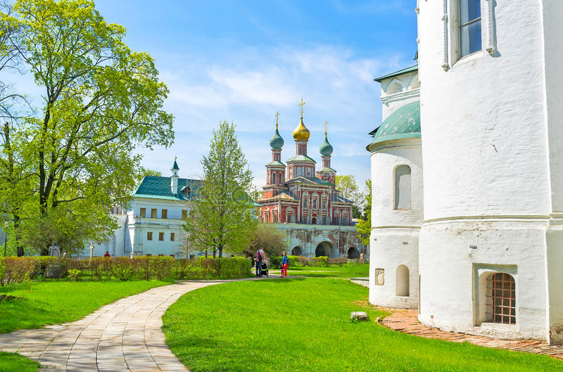 Walking in Novodevichy Convent. MOSCOW, RUSSIA - MAY 08, 2015: Novodevichy Convent consists of numerous beautiful medieval churches such as Smolensky Cathedral royalty free stock photography