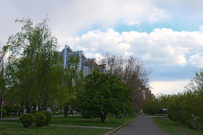 Walking in the old park. New high-rise buildings are visible behind the trees.Kiev. Ukraine stock image