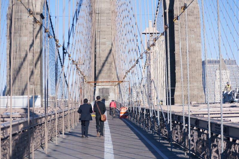Walking over Brooklyn Bridge New York City royalty free stock photography