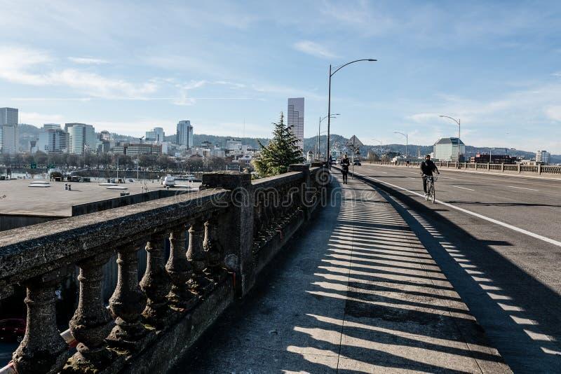 Walking over the Burnside Bridge we face the Westside downtown City Skyline of Portland Oregon. Walking over the Burnside Bridge we are facing the Westside stock image