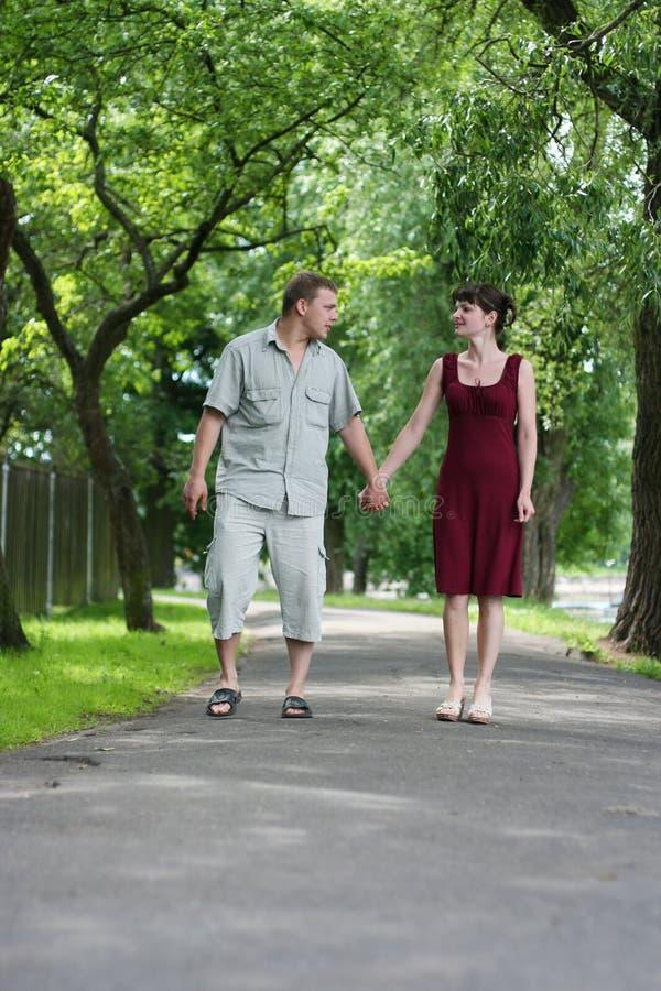 Walking in park. Loving couple walking in park stock photos