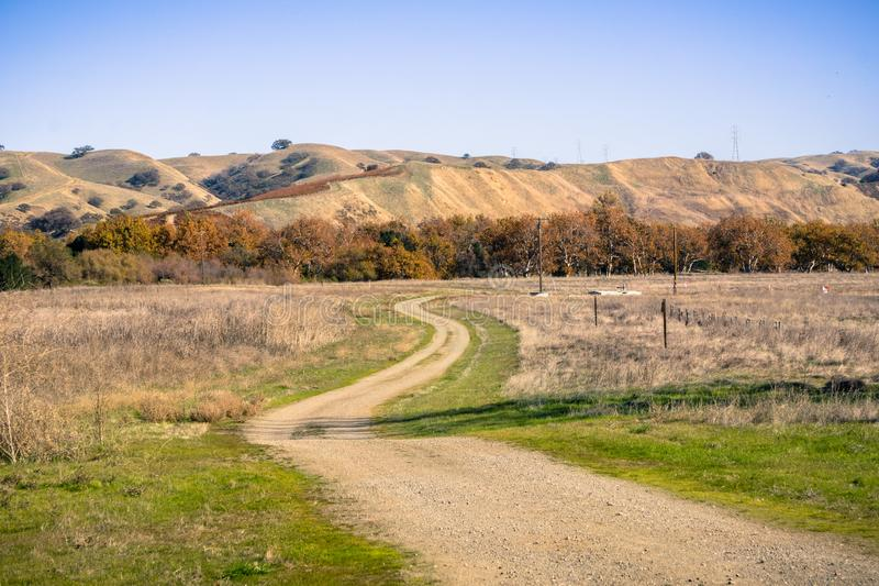 Walking path through grassland, Sycamore Grove Park, Livermore, east San Francisco bay, California royalty free stock photos