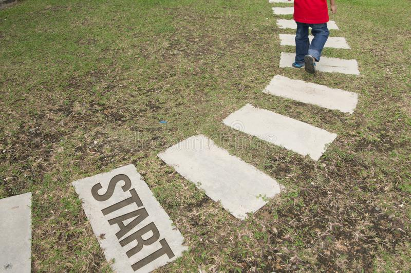 Walking path on a green grass royalty free stock photos