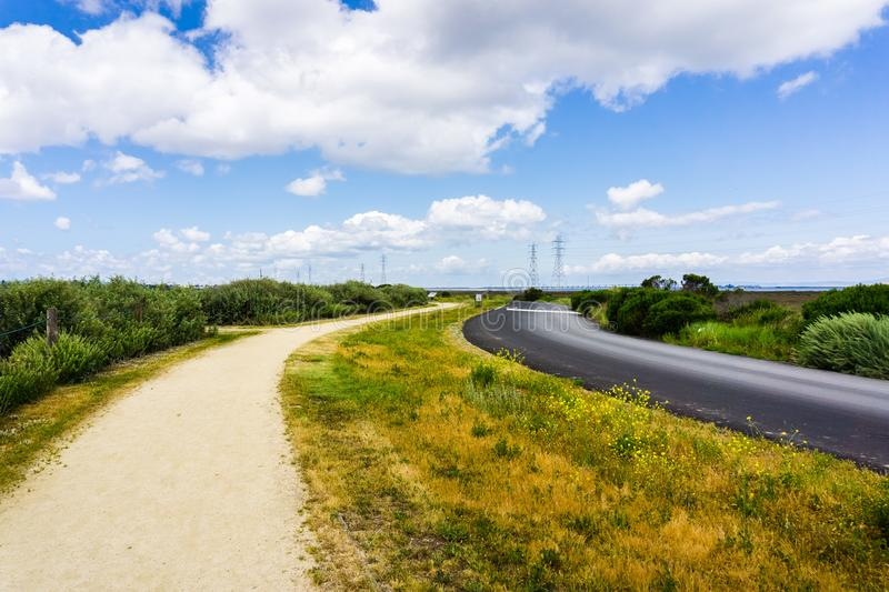 Walking path, Palo Alto Baylands Park, California. Walking path following the road in Palo Alto Baylands Park, south San Francisco bay area, California stock photography