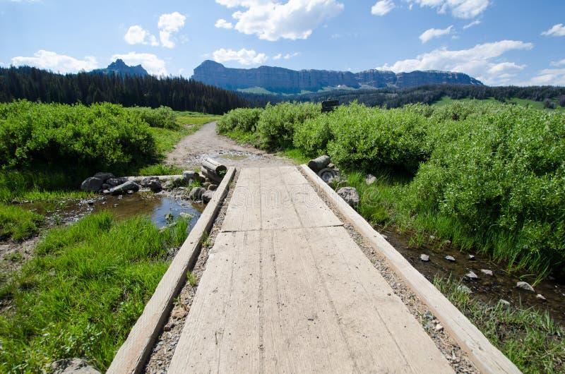 Walking path platform across a small creek in Brooks Lake Wyoming USA stock photos