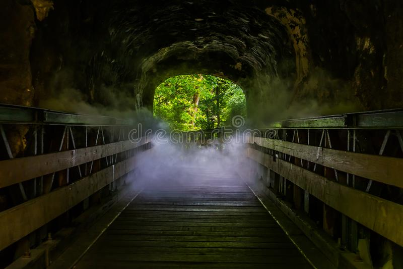 Walking path with scary smoke effect, creepy looking halloween cave, misty den, horror scenery royalty free stock image