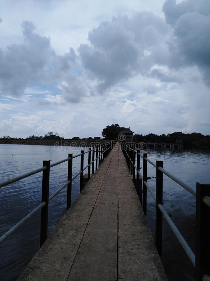 A long pathway in the middle of lake . royalty free stock photography