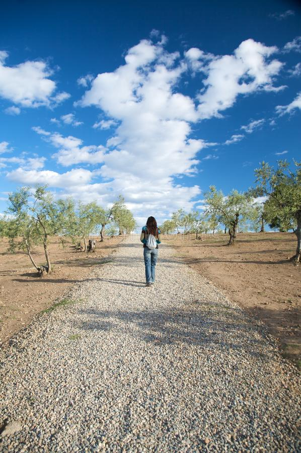 Walking on pebble path. Woman on pebble path in caceres extremadura spain royalty free stock image