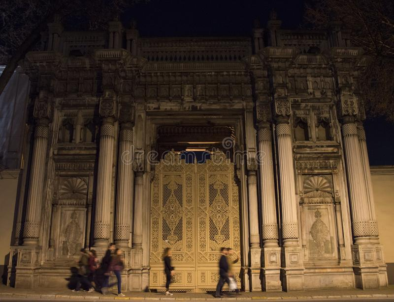 Walking people in front of Cıragan Palace stock photography