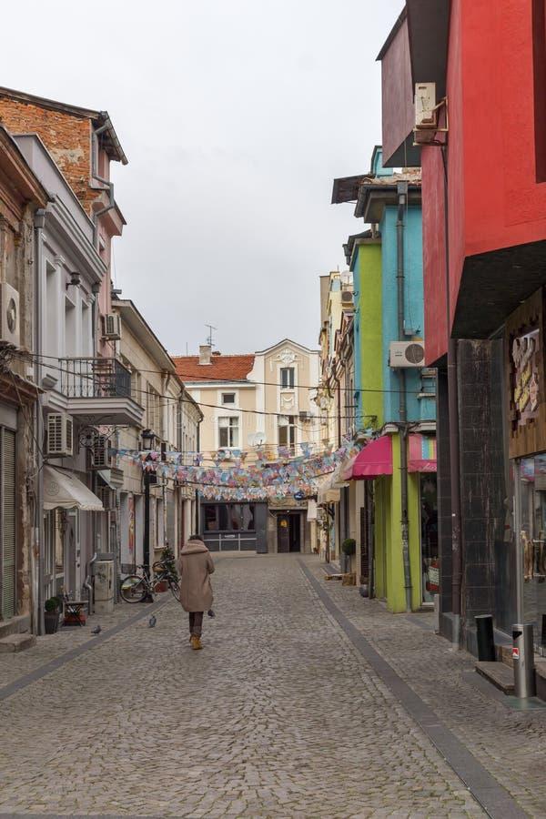 Walking people and Street in district Kapana, city of Plovdiv, Bulgaria. PLOVDIV, BULGARIA - DECEMBER 30, 2016: Walking people and Street in district Kapana royalty free stock photos