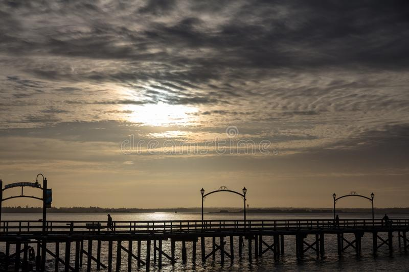 Walking on the pier, White Rock, BC, Canada royalty free stock photography
