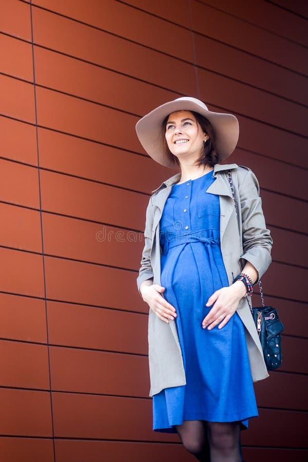 Walking pregnant brunette royalty free stock photos