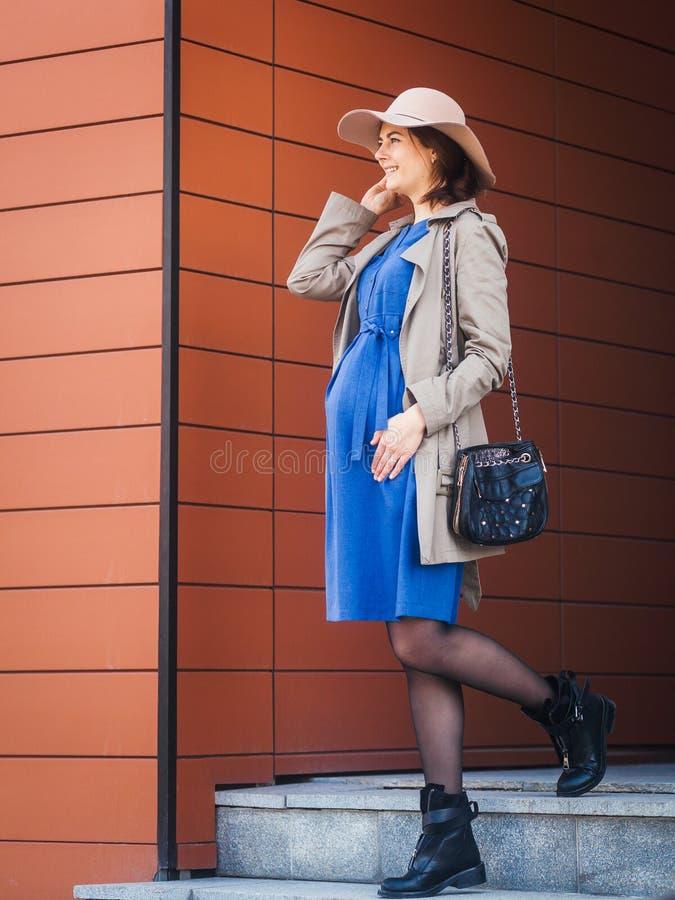 Walking pregnant brunette royalty free stock photo