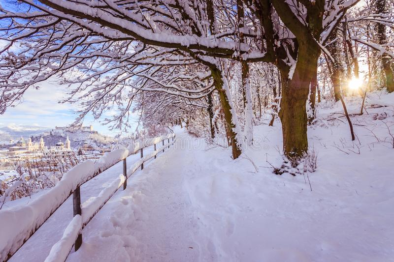 Walking promenade in Salzburg, snowy winter landscape royalty free stock photography