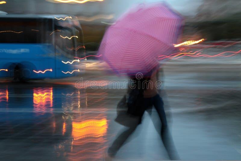 Walking in the rain stock image