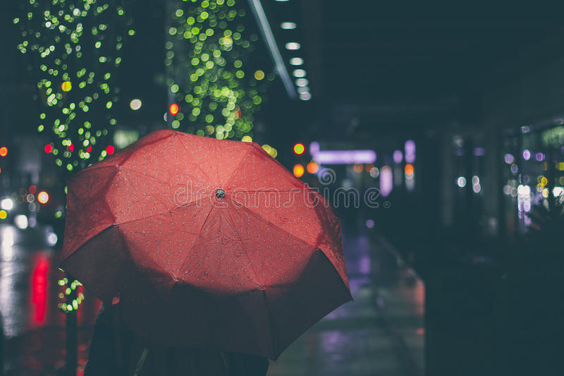 Walking on a rainy evening stock image