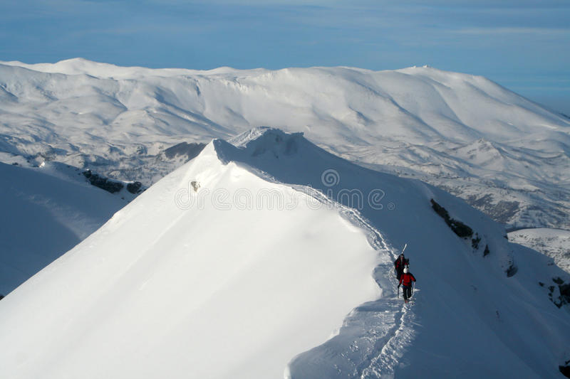 Walking on the ridge with skis stock images
