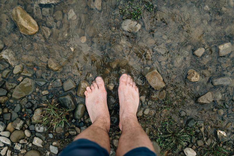 Walking on rocks with bare feet and unity with nature royalty free stock photo