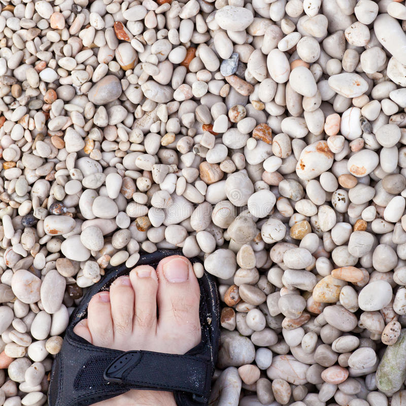 Walking on round gravel seashore