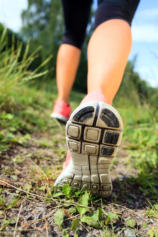 Walking or running legs in forest, adventure and exercising royalty free stock images