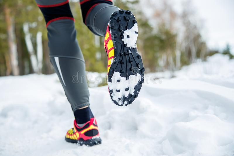 Walking or running legs sport shoes, fitness and exercising in autumn or winter nature. Cross country or trail runner outdoors stock photo