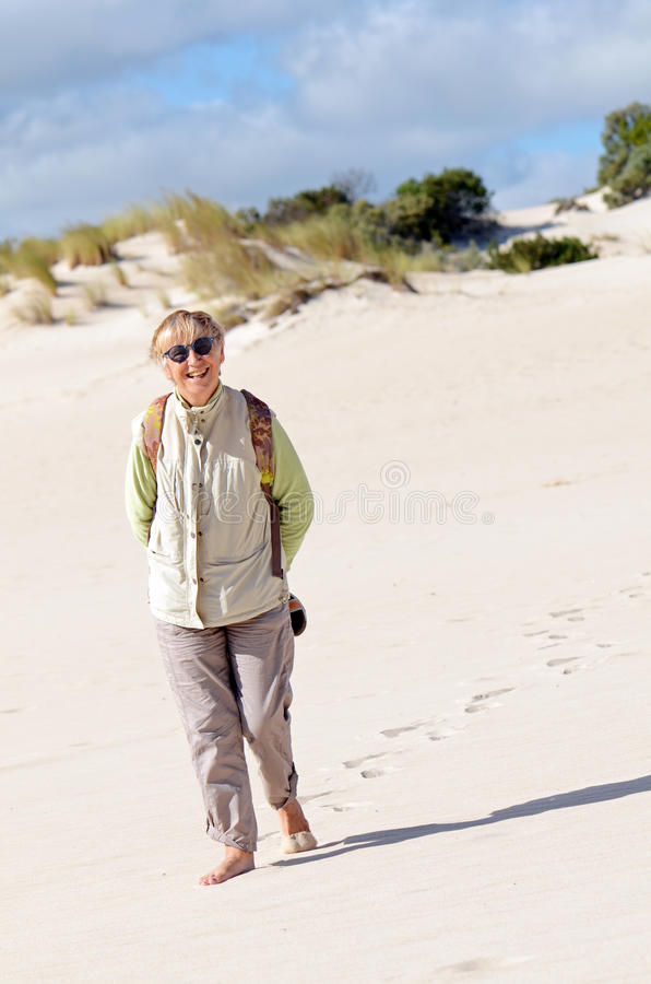 Download Walking On The Sand Dune Royalty Free Stock Photo - Image: 19040075