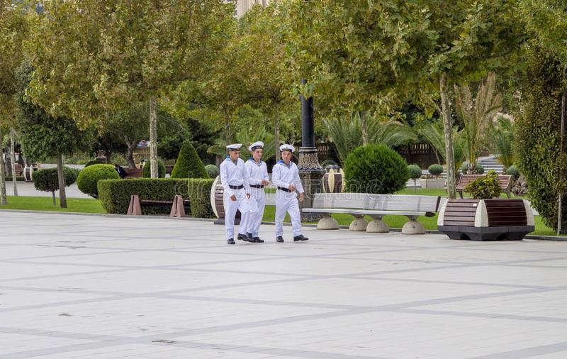 Sailors walking. The walking seamen, Baku, Azerbaijan royalty free stock photography