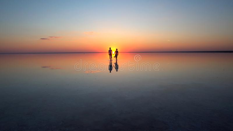 Walking into the setting sun royalty free stock photos