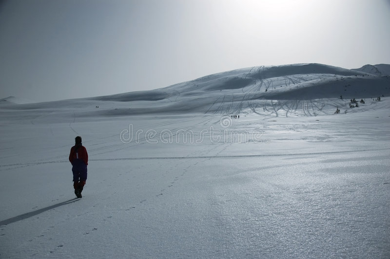 Walking in the snowy mountains stock image