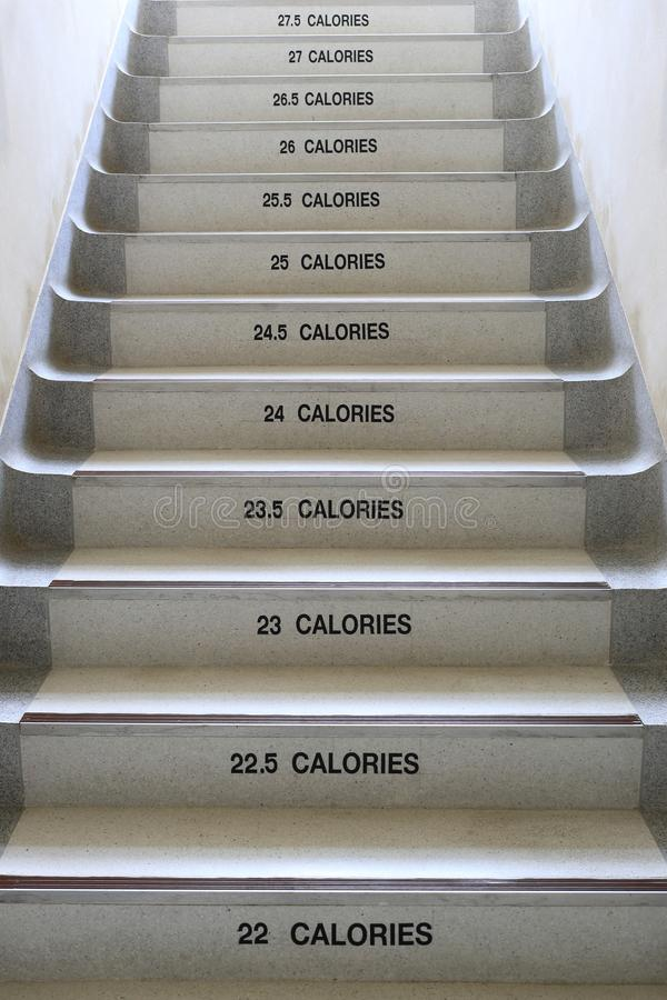 Walking stairs with ideas for fitness and energy saving. stock photos