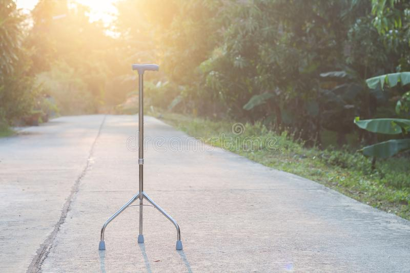 Walking stick laying on street in the morning background,staff c. Ane three legs stock photo