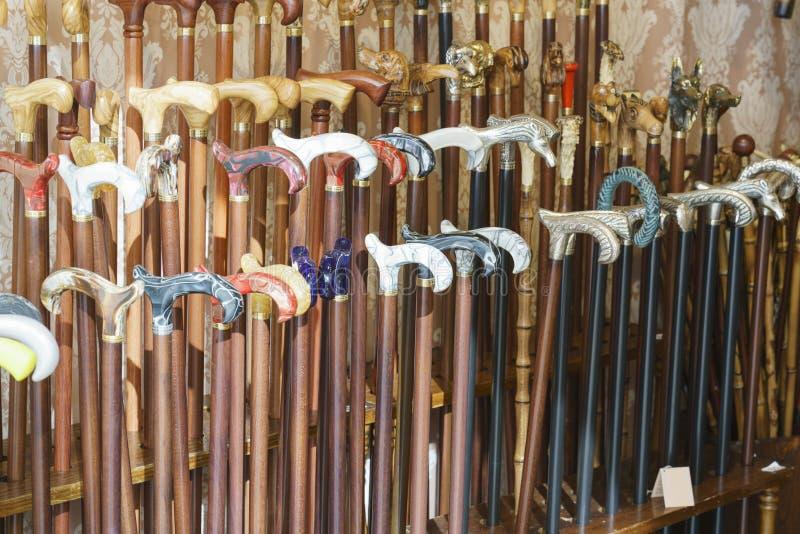 Walking sticks. Collection of handmade walking sticks. Handicrafts royalty free stock image