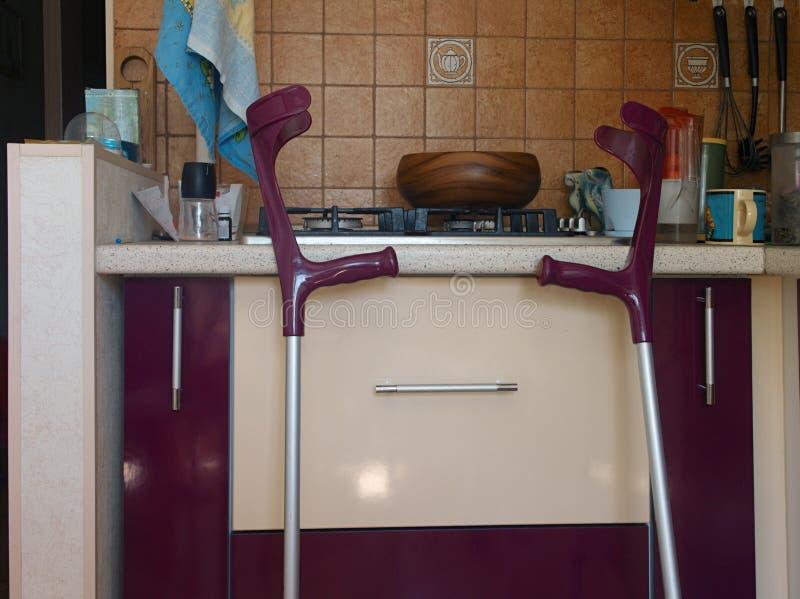 Walking sticks in kitchen. Two walking sticks in kitchen interior, indoor close-up royalty free stock photo