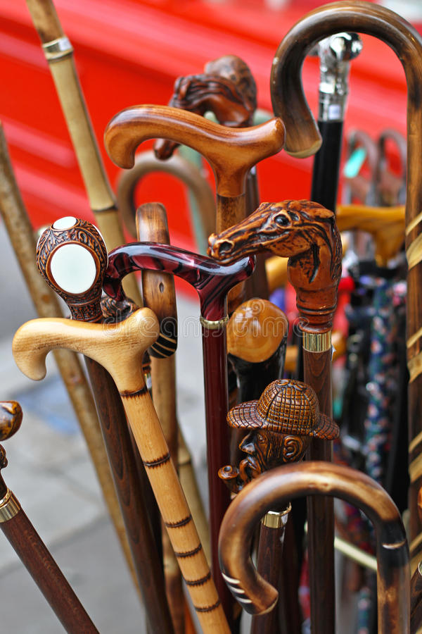 Walking sticks. Vintage style wooden walking sticks and canes stock photo