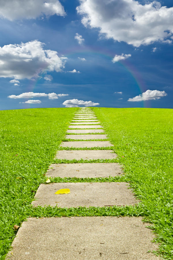 Walking stone to sky and rainbow royalty free stock images