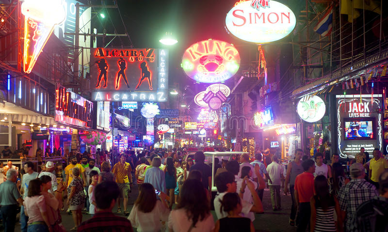Walking street. PATTAYA, THAILAND - MARCH 13: Nightlife on walking street on March, 2012 in Pattaya. Walking Street is a popular tourist attraction. It is a red