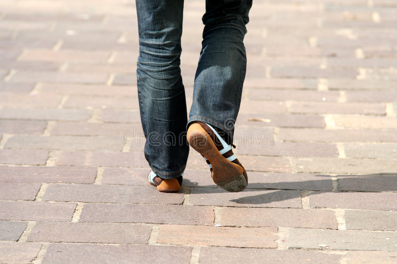 Walking in the street. Woman legs walking in the street royalty free stock images