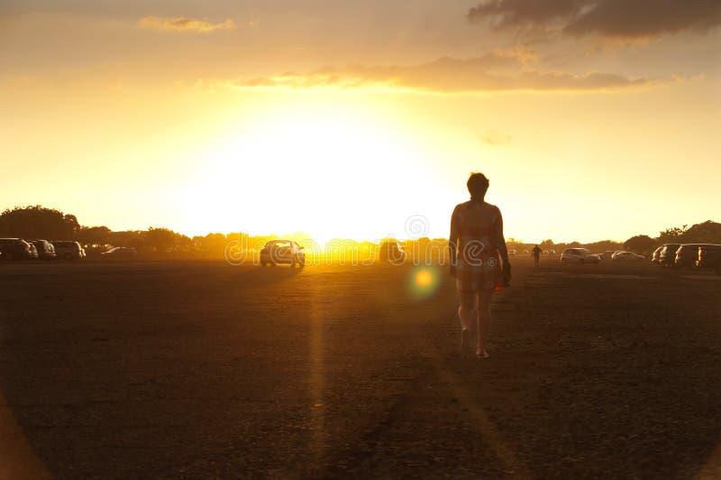 Walking at sunset stock photos
